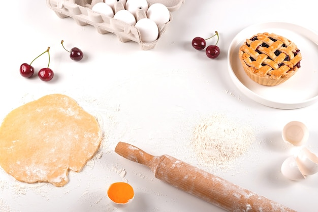 Cooking homemade mini cherry pie - autumn food concept