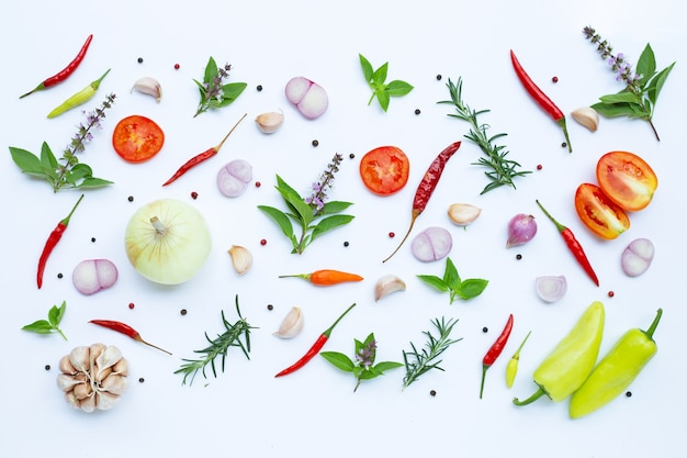 Cooking ingredients, various fresh vegetables and herbs on white wall. healthy eating concept