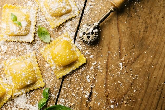 Cooking italian ravioli on wooden table