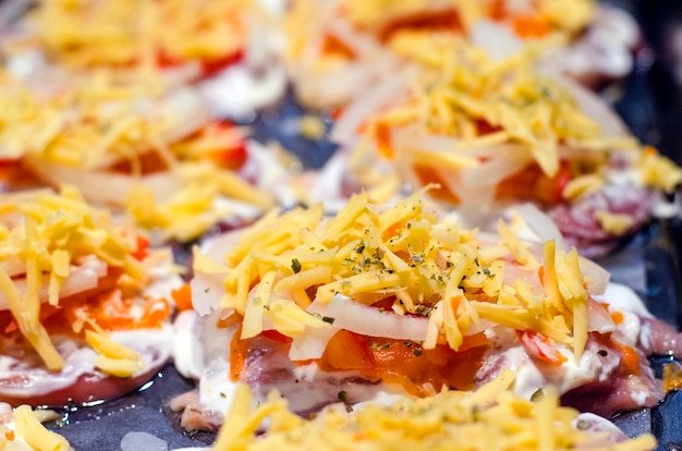 Cooking meat with pineapple vegetables and cheese for baking