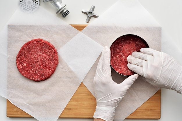 Cooking a prime black angus beef burger patties.