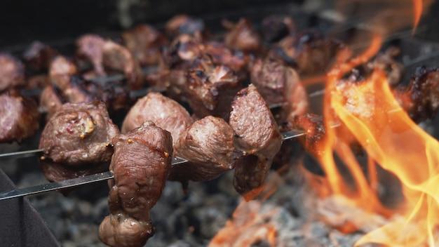 Cooking shish kebab or shashlik on skewers