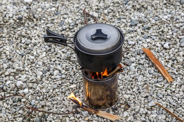 Cooking on a small camping stove in a mountain camp.