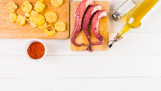 Cooking table with potatoes and octopus