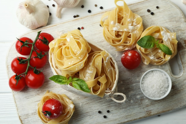 Cooking tasty pasta on white wooden table