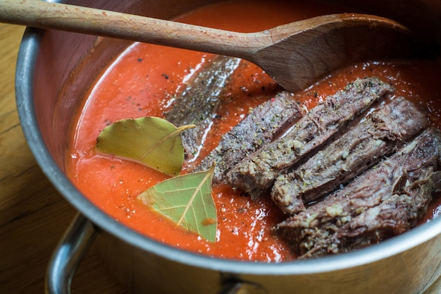Cooking tender beef with tomato sauce