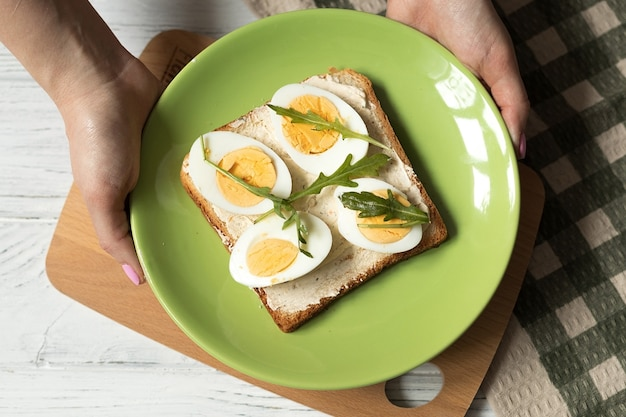 Cooking toast with boiled egg top view