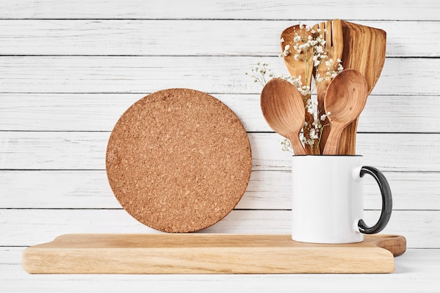 Cooking utensils and cutting board on white table