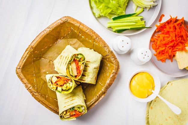 Cooking vegan tofu wraps with cashew cheese sauce and vegetables,
