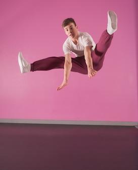 Cool break dancer mid air doing the splits