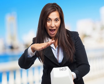 Cool business-woman with control key
