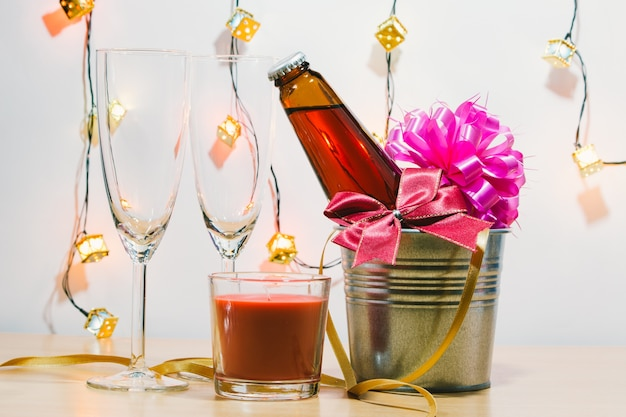 Cool champagne and glass prepare for celebration. red candle in christmas