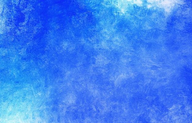 すりおろしたコンクリートの質感のあるクールな色の青いグラデーション。カラフルな青い背景