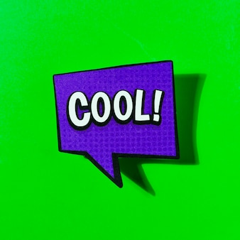 Cool comic book bubble text pop art retro style on green background