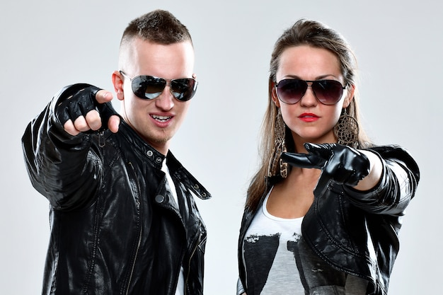 Cool couple in leather clothes