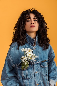 Cool ethnic woman with flowers on jacket