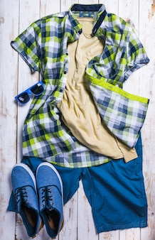 Cool fashion casual men outfit on wooden table