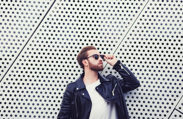 Cool fashion men in leather jacket