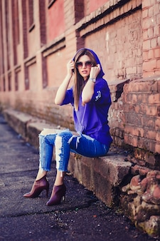 Cool girl wearing jeans and sunglasses