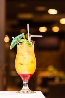 Cool orange cocktail on a blurry background