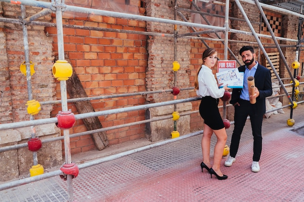 Cool real estate agents posing with scaffold