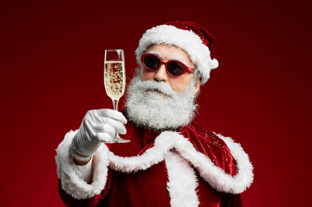 Cool santa claus drinking champagne