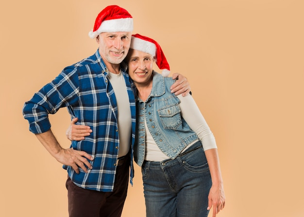 Cool senior couple with christmas hat