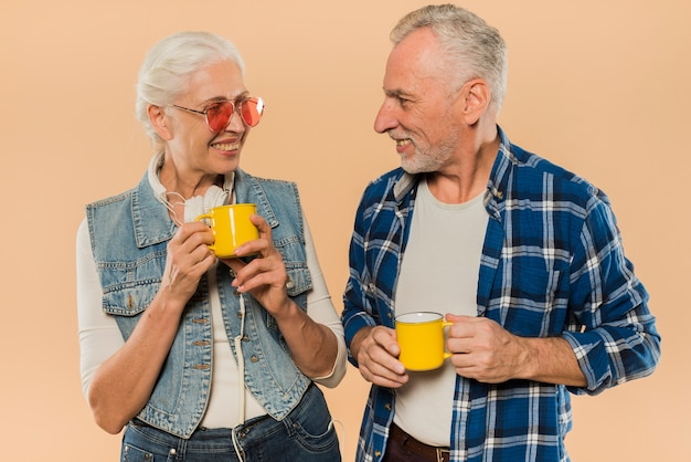 Cool senior couple with mugs