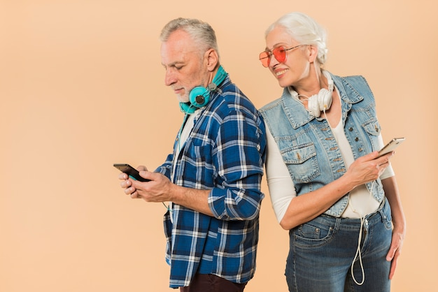 Cool senior couple with smartphone