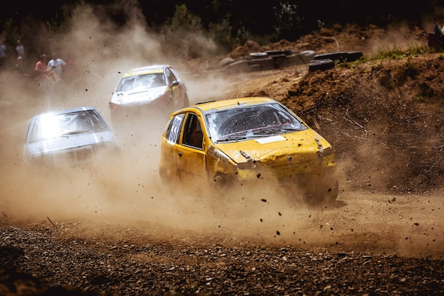 A cool shot of cars racing on a dirt road