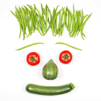 Cool vegetables face on white background