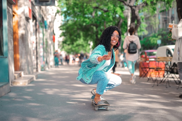 Cool woman skateboarding