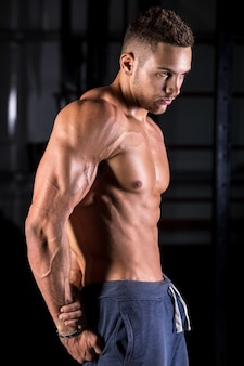 Cool young bodybuilder posing