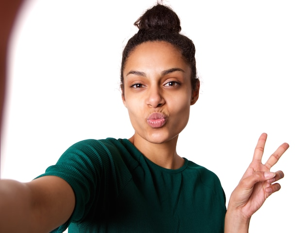 Cool young woman taking selfie