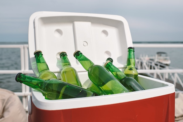 Cooler box with glass of refreshing drinks or beer prepared for birthday party