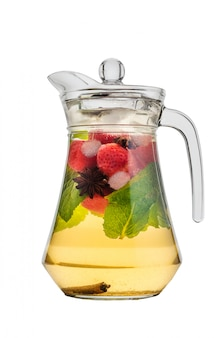 Cooling tea with strawberries and mint in a glass jar and spices