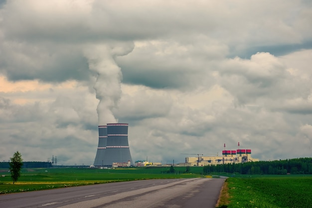 Cooling towers of nuclear power plant against the cloudy dramatic sky in ostrovets, grodno region, belarus.