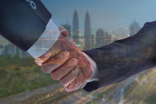 Cooperation businessman shake hand with double exposure