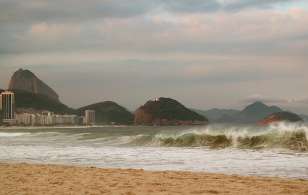 Copacabana beach striking by ocean waves