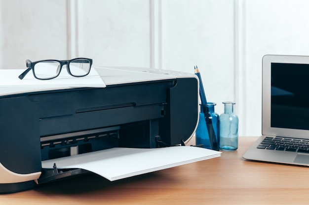 Copier or printer in a modern office interior close up