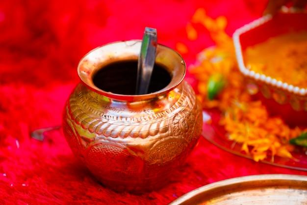 Copper kalash in wedding ceremony