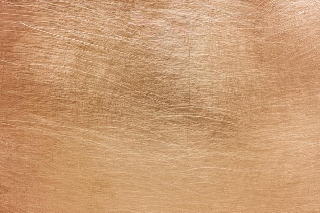 銅または真ちゅうの背景、非鉄金属の質感