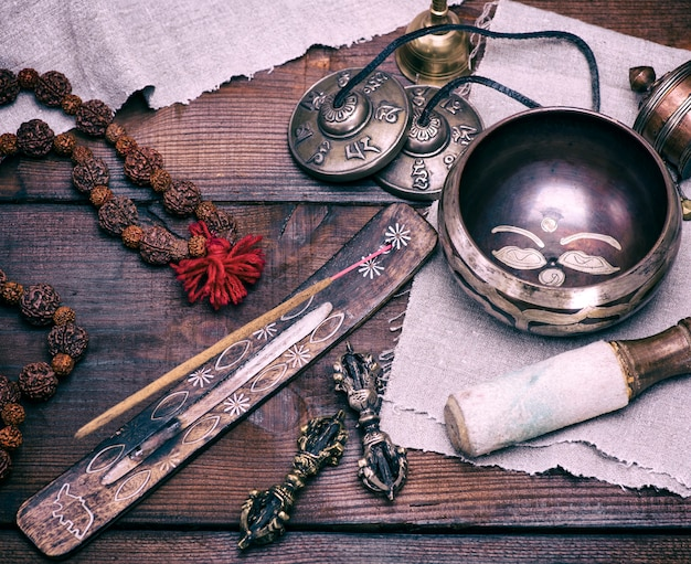 Copper singing bowl and incense stick