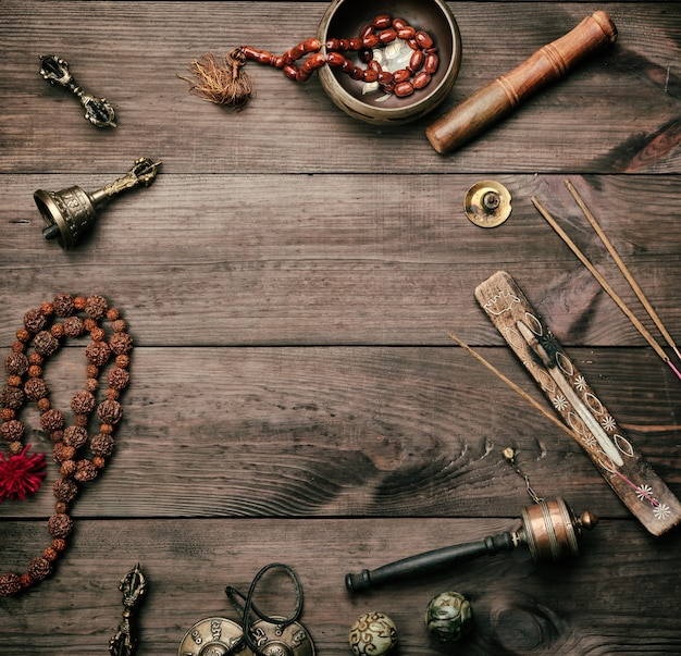 Copper singing bowl, prayer beads, prayer drum and other tibetan religious objects for meditation
