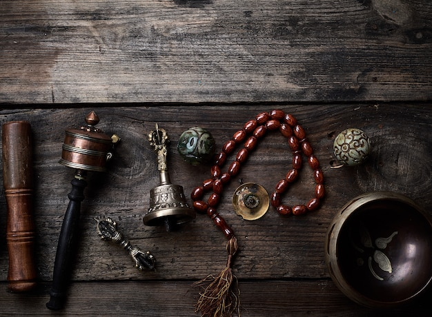 Copper singing bowl, prayer beads, prayer drum and other tibetan religious objects