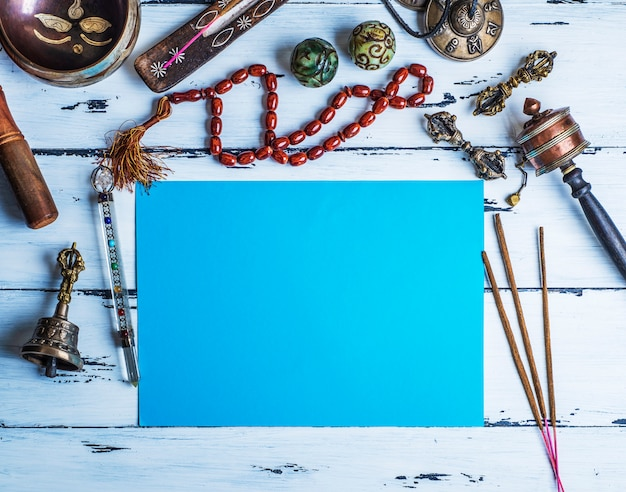 Copper singing bowl, prayer beads, prayer drum