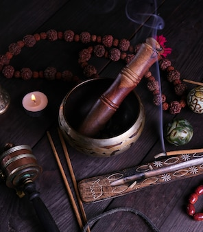 Copper singing bowl and a wooden stick