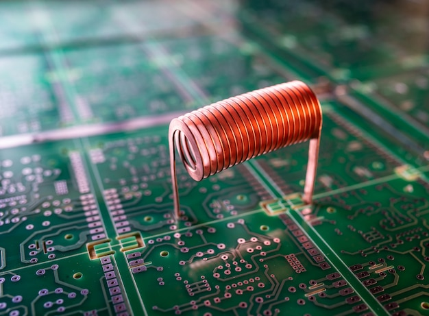 Copper wire stands on a green microcircuit