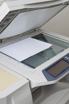 Copy machine and paper isolated on white