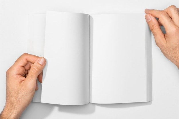 Copy space book and hands
